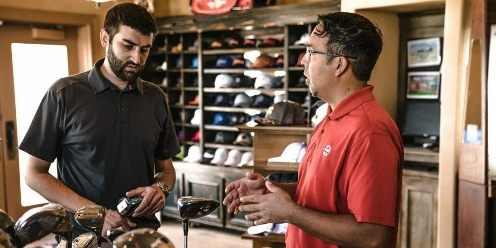 two men in a golf pro shop