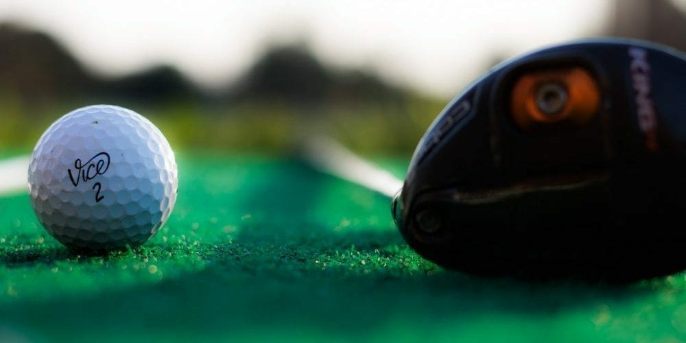 a golf driver and a ball